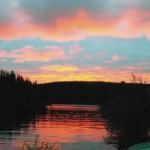 Sunrise on Thompson Lake in Saskatchewan Canada by Charles Suttles